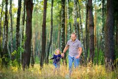 Dad walks in the park with his beloved daughter stock images