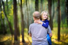 Dad walks in the park with his beloved daughter at sunset royalty free stock images
