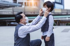 Free Dad Wearing Protective Face Mask To Son When Covid-19 Or Epidemic Situation Before Go To School  Business Father Love Child Royalty Free Stock Image - 208388426