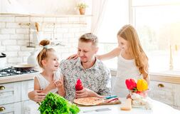 Dad With Daughters Preparing Pizza Royalty Free Stock Images
