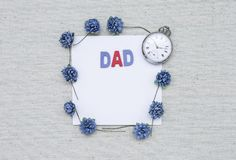 Dad wooden text on blank white paper card with vintagee watch and paper flower frame stock photos