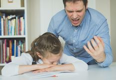 Dad is yelling. Dad is yelling because his daughter don`t want to do her homework royalty free stock photo