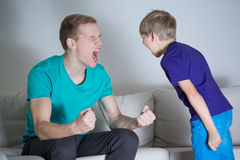 Dad yelling at his son Royalty Free Stock Photos