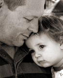 Daddy. Father and baby in black and white Stock Image