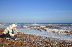 Daddy and baby. Daddy with his baby on the beach Royalty Free Stock Photo