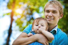 Daddy with  baby in a greenl summer park Royalty Free Stock Photos