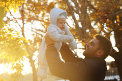 Daddy with the baby for a walk in the park stock photography