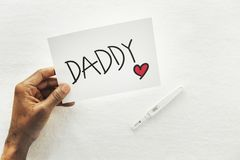 Daddy card pregnancy test announcement royalty free stock photography
