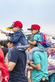 Fathers carried sons on shoulders, Bandung Air Show 2017. royalty free stock photos