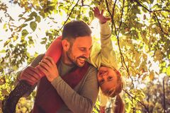 Daddy carrying daughter on back trough nature. Single smiling father with daughter royalty free stock photography