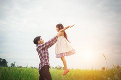 Daddy carrying his daughter with nature and sunlight, enjoyment. Family Royalty Free Stock Photo