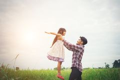 Daddy carrying his daughter with nature and sunlight, enjoyment. Family Royalty Free Stock Photography