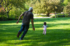 Daddy chasing after little girl stock images