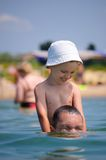 The daddy with the child in the sea Stock Photo