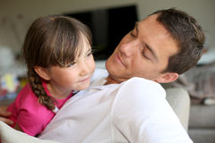 Daddy and daugher playing together on sofa Stock Images