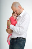 Daddy and Daughter. Father and daughter relaxing in a studio setting royalty free stock photos