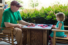 Daddy Daughter Checkers Royalty Free Stock Image