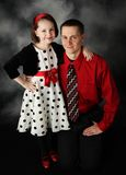 Daddy and daughter dressed up. Portrait of father and daughter dressed up in red, black, and white hugging Stock Photos