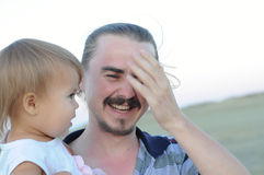 Daddy with daughter laughing Royalty Free Stock Image
