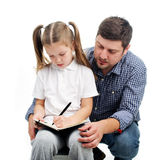 Daddy helps with homework Stock Images