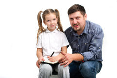 Daddy helps with homework Stock Photos