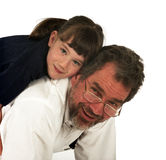 Daddy and his Girl. A father with his daughter hugging in  a studio setting with a white background Stock Image
