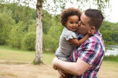 Daddy and his little girl. Blank father with his african daugther having a nice time royalty free stock photo