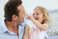 Daddy and his little girl playing together Royalty Free Stock Photography