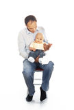 Daddy with his unhappy baby Stock Photos