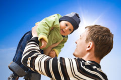 The daddy holding the child. In hands Stock Photo