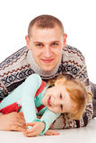 Daddy hugged the little girl, lying, posing Royalty Free Stock Photos