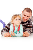 Daddy hugged the little girl, lying, posing Stock Photo