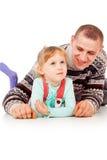 Daddy hugged the little girl, lying, posing Stock Photo