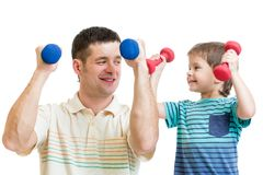 Daddy and kid son doing exercise with dumbbells Stock Photo