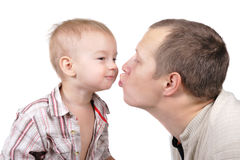 Daddy kisses his little son Royalty Free Stock Photos