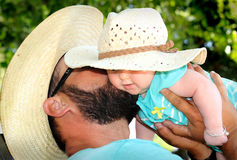 Daddy Kisses Newborn Stock Photos
