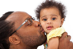 Daddy Kissing Baby Girl Stock Images