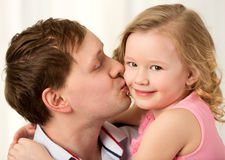 Daddy kissing beautiful little daughter Royalty Free Stock Photo