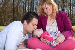 Daddy is kissing his baby girl royalty free stock images