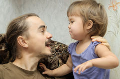 Daddy and little girl communicating actively Stock Photos