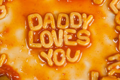 Daddy loves you. Alphabet shaped pasta forming DADDY LOVES YOU in tomato sauce Stock Image