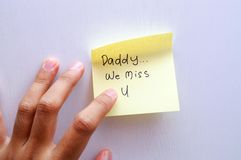Daddy We Miss You. A Post-it note on the door from kids to their daddy telling how much they miss him Stock Photo