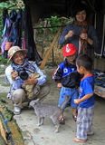 Daddy, mom and two sons are walking in tourist. Sa Pa, Vietnam - June 6, 2015: Daddy, mom and two sons are walking in tourist area CatCat Stock Photo