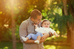 Daddy playing active games with his son outside. Happy family portrait. Laughing dad with little boy enjoying nature together stock images
