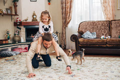 Daddy plays with his little daughter Stock Image