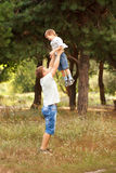 Daddy raising up the child. Royalty Free Stock Image