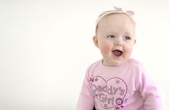 Daddy's Girl. A young, happy, laughing, baby girl Royalty Free Stock Images