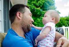 Daddy& x27;s girl. An adorable baby girl basks in the loving gaze from her daddy Stock Image