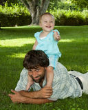 toddler on daddys shoulders Stock Photography