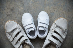 Daddy`s sneakers and baby`s sneakers Royalty Free Stock Photos